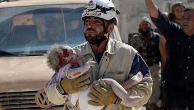 "A civil defense member carries an injured baby who was pulled out from under debris in Syria. | Photo: Reuters This content was originally published by teleSUR at the following address: ""http://www.telesurtv.net/english/news/Report-Finds-US-Airstrikes-Did-Kill-6-Children-in-Syria-20151127-0002.html"". If you intend to use it, please cite the source and provide a link to the original article. www.teleSURtv.net/english"